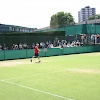 Sam hitting with coach in Wimbledon practice court